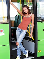 Gorgeous dark haired teen chick undressing and showing her lovely slim body in the bus.
